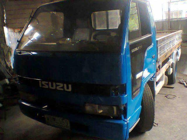 Isuzu elf dropside blue