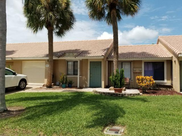 Nicely Updated 2/2/1 Villa With Cathedral Ceiling In Living Room And Tile Flooring Throughout
