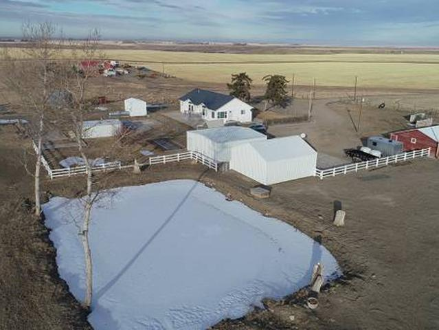 Ranch Style Home On 20 Acres With Garages, Barn, Pond Pool Conrad