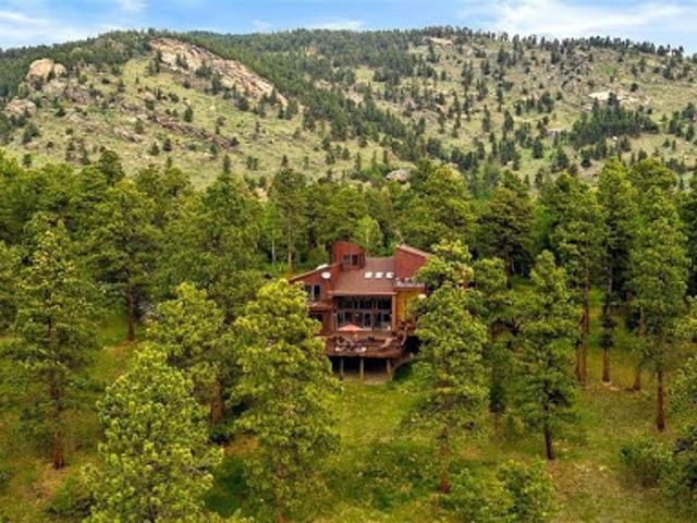 Seclusion And Convenience On This 15 Acre Evergreen Estate